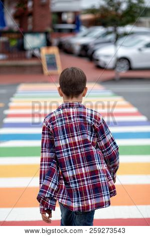 Teenager Walking On Rainbow Crosswalk. Sexual Identity. Coming Out. The Concept Of Lgbt. Vertical