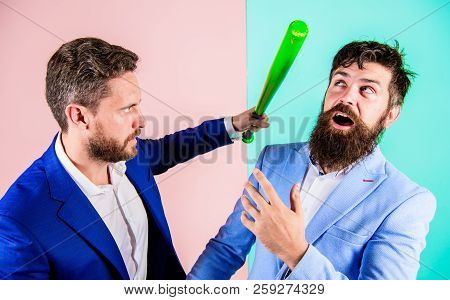Threat With Violence. Businessman Raise Bat While Shaking Hands. Business Partners Competitors Offic