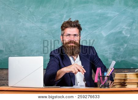 Teacher Formal Wear Sit Table Classroom Chalkboard Background. Pay Attention To Details. Teacher Con