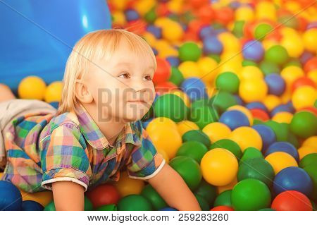 Happy Baby At Playground. Little Child At Indoor Play Center. Happy Childhood. Child Playing With Co