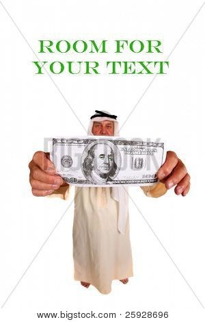 A laughing man wearing an Arabic headdress, keffiyeh and agal holds a Giant $100.00 dollar bill to the camera, isolated on white with room for your text. Focus on the money in his hand.