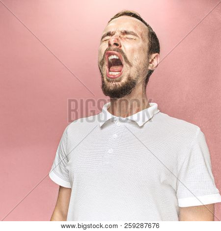 Young Funny Handsome Man With Beard And Mustache Sneezing With Spray And Small Drops, Studio Portrai