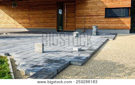 Laying Gray Concrete Paving Slabs In House Courtyard Driveway Patio.