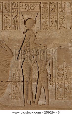 Goddess Hathor feeding Horus, a relief from the Ptolemaic period in Dendara, Egypt poster