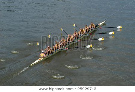Rowing team rowing ahead during a boat-race on the River Vltava in Prague, Czech Republic.