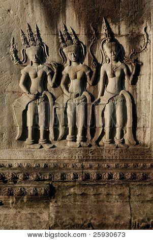 Apsara dancers at the bas-relief of Angkor Wat Temple in the Angkor Area near Siem Reap, Cambodia.