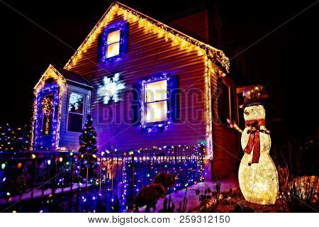 House Decorated For Christmas. Beautiful Christmas Decorations Outside The House At Night. Selective