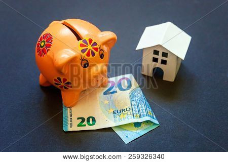 Euro Banknotes, Piggy Bank And Symbolic Miniature White Toy House. Buying Property And Mortgage. Sav