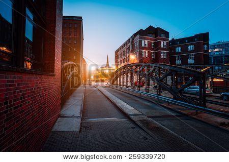 Empty Poggenmuehlen Bridge At Twilight. Hamburg, Germany. Illuminated Buildings And Last Sunrays. Wa
