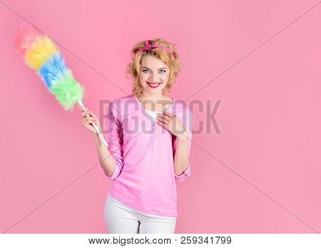 Cleaning woman. Happy girl hold colorful duster brush. Cleaning service. Girl cleaner with feather duster. Housewife with cleaning sweep. Woman from professional cleaning service with synthetic duster poster