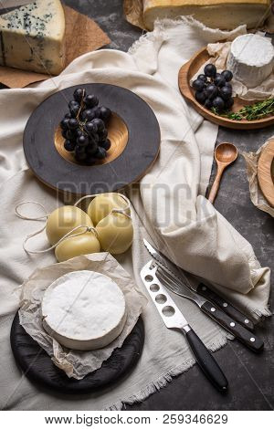 Scamorza And Goat Cheese With Pears, Grape And Honey On Dark Wooden Table
