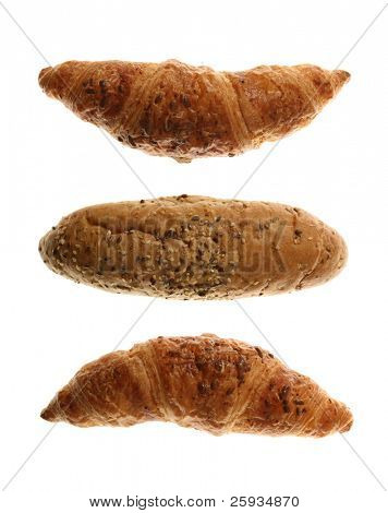 Bread rolls and croissants isolated on white