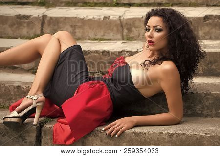 Seductive Pretty Sexy Brunette Young Busty Woman Having Bright Fashion Makeup Long Curly Hair Lookin