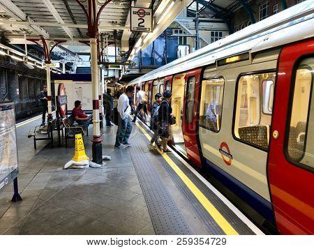 LONDON - SEPTEMBER 19, 2018: Passengers at Aldgate Underground Station in London, UK.