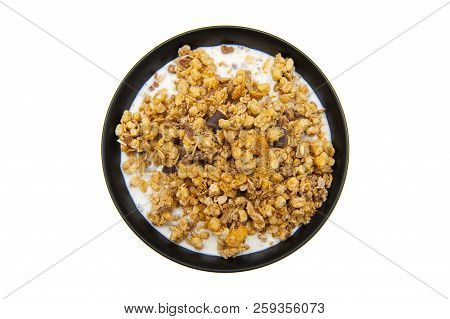Muesli With Chocolate And Milk Isolated On White Background