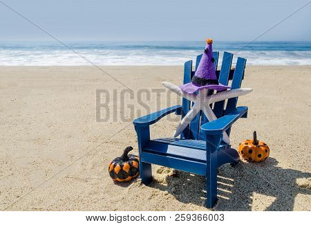 Halloween Background On The Beach With Starfishes In Witch's Hats