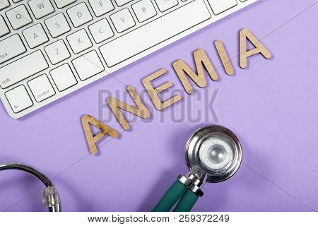 Keyboard And Stethoscope On Lilac Background, With The Word Anemia