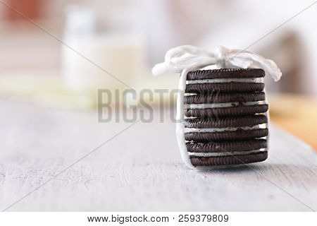 Delicious Chocolate Cookies Whit Vanilla Cream And Fresh Glass Of Milk In Background/ Conceptual Ima