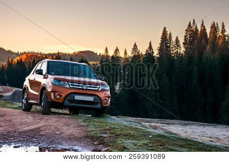 Apuseni, Romania - Oct 15, 2017: Orange Suzuki Vitara 4wd Suv Parked In Mountain At Sunrise. Beautif