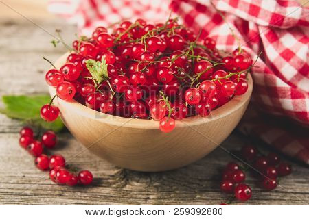 Red Currant In The Wooden Bowl And Napkin