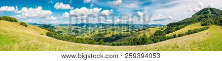 Panorama Of Beautiful Autumn Countryside. Forest Behind The Meadow. Gorgeous Cloudscape On The Sky A