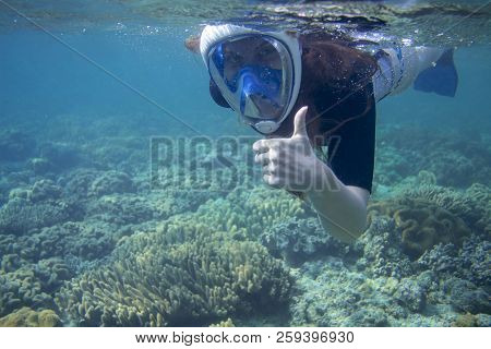 Snorkeling Woman Show Thumb Up. Snorkel In Coral Reef Of Tropical Sea. Young Girl In Full-face Snork