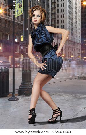 High fashion urban portrait of young, slim, beautiful model.
