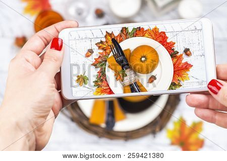Woman Taking Photo Of Thanksgiving Day Table Setting. Trendy Instagram Photo Shot. Copy Space. Top V