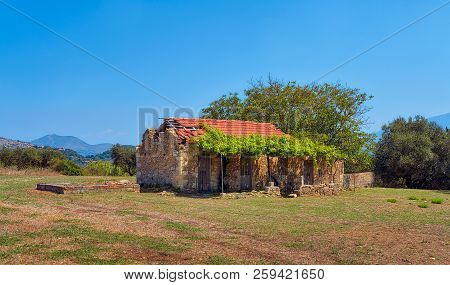Abandoned Ruined Old Farmer Cottage In Greece