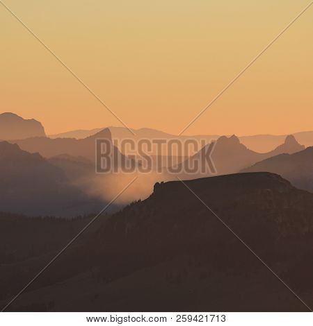Silhouettes Of Mount Wiriehore And Other Mountains In The Bernese Oberland. Golden Sunset In The Swi