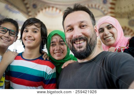 Muslim family portrait in masjid