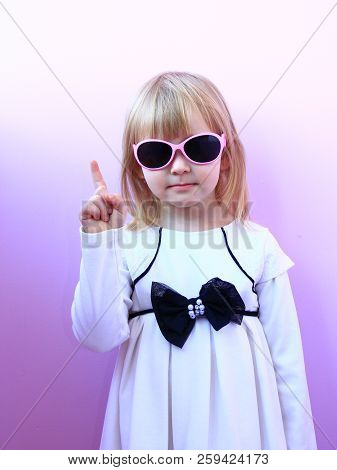 Beautiful Girl Threatening Finger. Young Serious Girl Shaking Her Finger. Little Girl In Sun Glasses