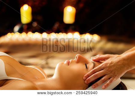 Close Up Of Young Woman Having Healing Head Massage In Spa.therapist Doing Manipulative Treatment Wi