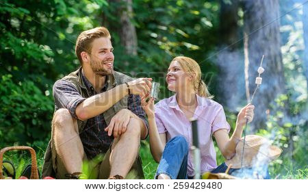 Food For Hike And Camping. Couple Sit Near Bonfire Eat Snacks And Drink. Weekend Picnic. Couple Take