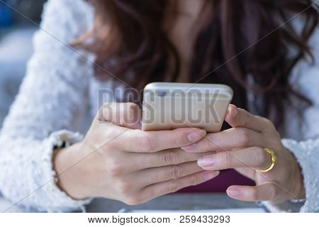 Close Up Female Hands Holding Using Mobile Smart Phone. Business Woman Typing Text Messages On Touch