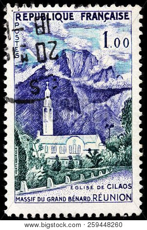 Luga, Russia - September 12, 2018: A Stamp Printed By France Shows View Of Grand Benard And Catholic