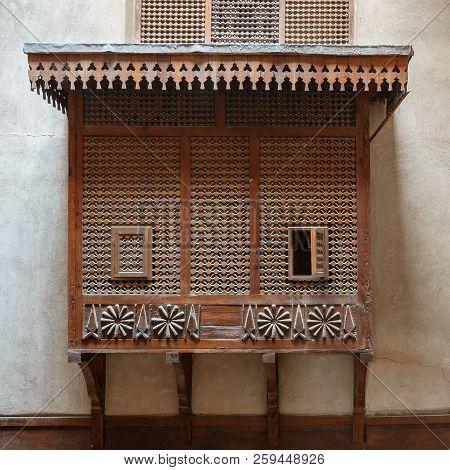 Mamluk Era Style Oriel Window Covered By Interleaved Wooden Grid (mashrabiya) On Stone Wall, Facade