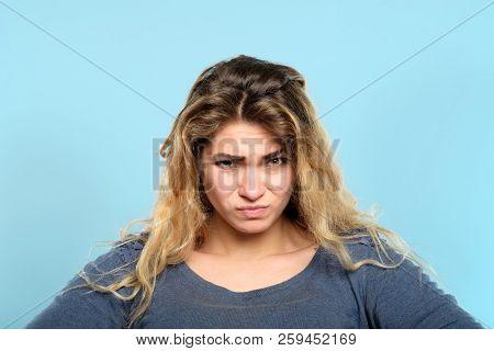 Distrustful Skeptic Look. Dissatisfied Discontented Displeased Disgruntled Woman Portrait On Blue Ba