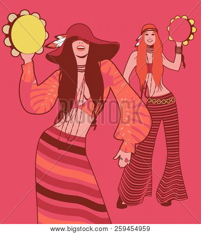Two Girls Playing Tambourines Wearing Hippie Clothes Of The 60S And 70S