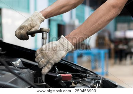 People Are Repair A Car Use A Wrench And A Screwdriver To Work.safe And Confident In Driving. Regula