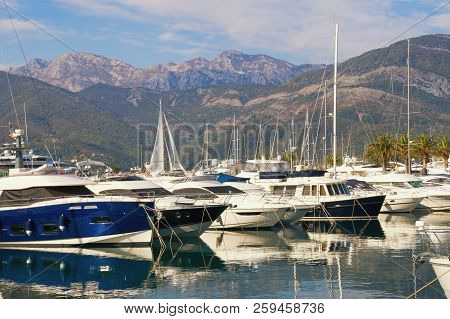 Port For Yachts On The Background Of Mountains. Montenegro, Bay Of Kotor, Adriatic Sea, Tivat City.