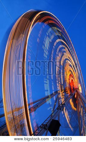 One of the crazy festival ferris wheels in Prague. Beautiful neon light show.