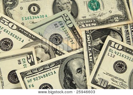 Banknotes of United States of America - dollars - one heap. There are all included - 100, 50, 20, 10, 2 and a 1 dollar bills in this money background
