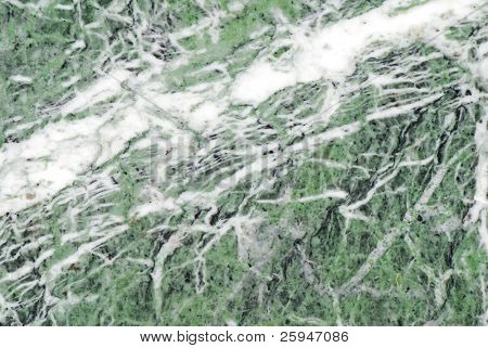 Marble abstract background with quarz and green particles