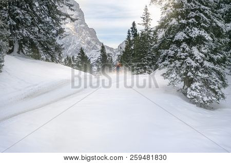 Winter Landscape With Snowy Fir Trees, Hills Covered In Snow And A  Road Through The Austrian Alps,
