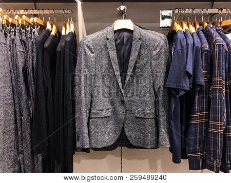 Rows of men's suit ,jackets,pants, in shop