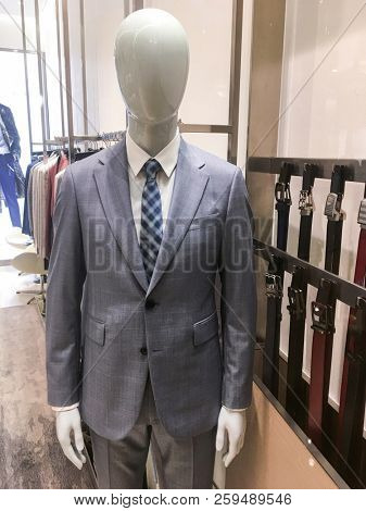 Stylish men's suit. on a mannequin. Men's Clothing.. Clothing store. Shopping in boutiques