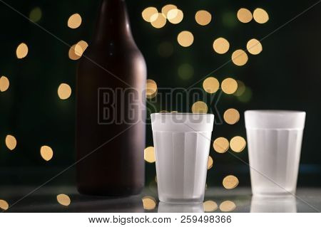 Bottle Of Beer And An Empty American Cup
