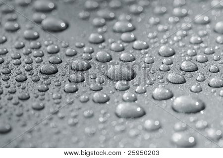 Droplets on a car. Short depth of field. The image may appear grainy, but it's caused by the metallic paint.