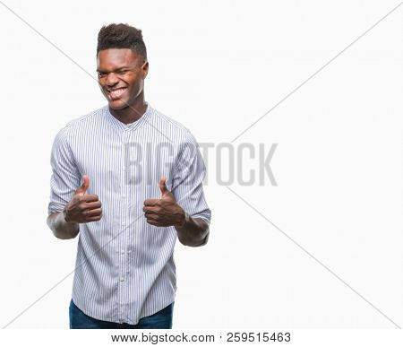 Young african american man over isolated background success sign doing positive gesture with hand, thumbs up smiling and happy. Looking at the camera with cheerful expression, winner gesture.